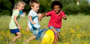 kids-chase-ball-in-summer-612x300